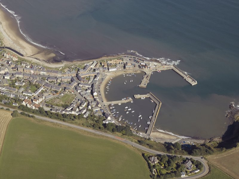Oblique aerial view centred on the harbour, taken from the SSW.