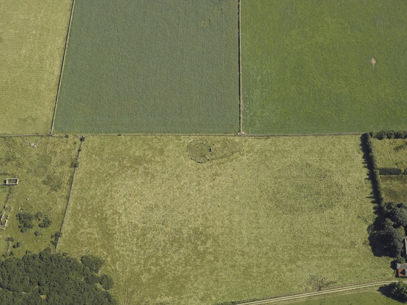 Oblique aerial view centred on the remains of the recumbent stone circle, taken from the W.