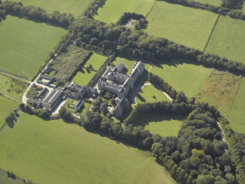 Oblique aerial view centred on the college, church, chapel, dovecot, walled garden and cottage, taken from the NE.
