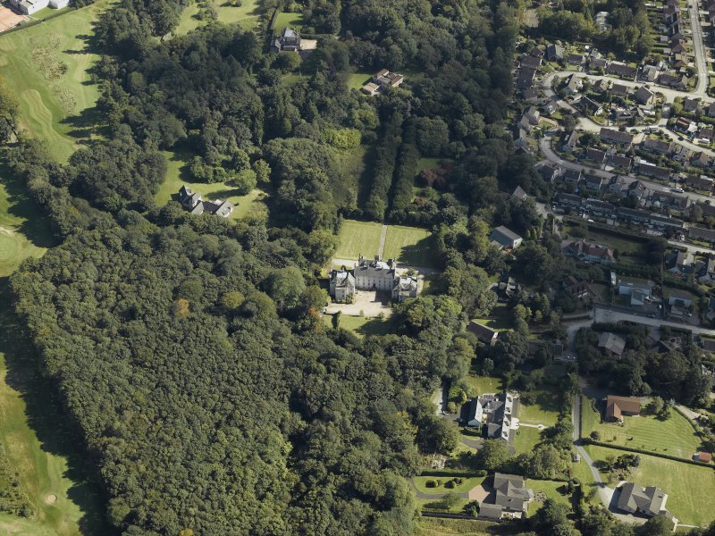 Oblique aerial view centred on the country house, gardens and dovecot with the cottages adjacent, taken from the NW.