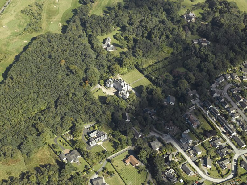 Oblique aerial view centred on the country house, gardens and dovecot with the cottages adjacent, taken from the W.