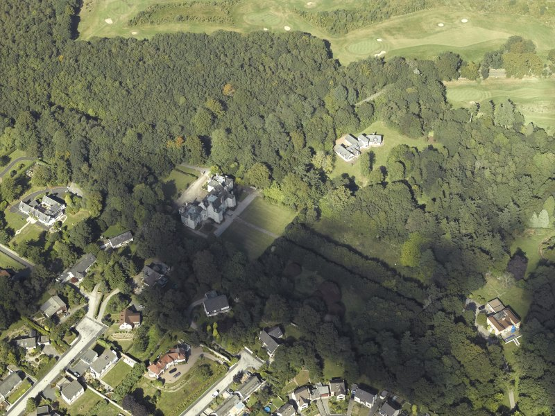 Oblique aerial view centred on the country house, gardens and dovecot with the cottages adjacent, taken from the S.