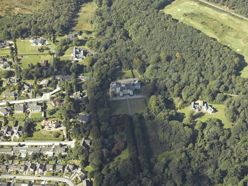 Oblique aerial view centred on the country house, gardens and dovecot with the cottages adjacent, taken from the SSE.