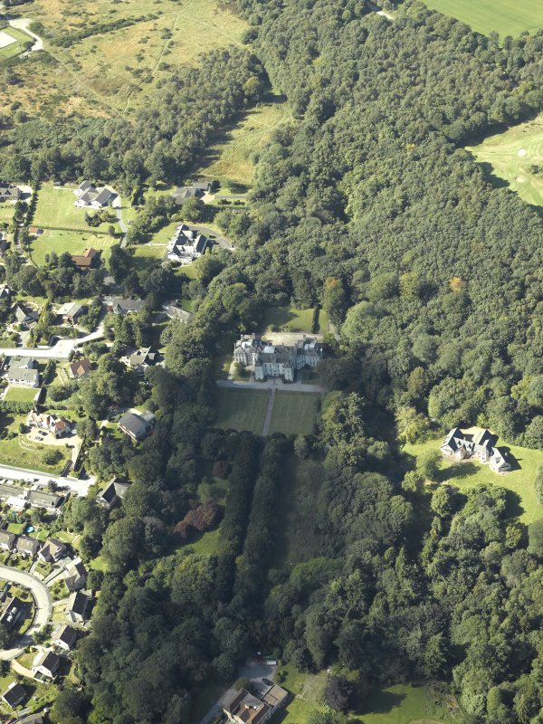 General oblique aerial view centred on the country house, gardens and dovecot with the cottages adjacent, taken from the SE.