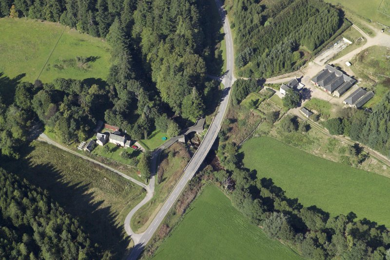 Oblique aerial view centred on the shooting lodge and road bridge, taken from the S.
