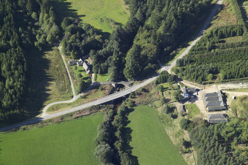 Oblique aerial view centred on the shooting lodge and road bridge, taken from the SE.