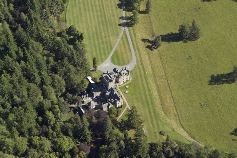 Oblique aerial view centred on the country house, taken from the NW.