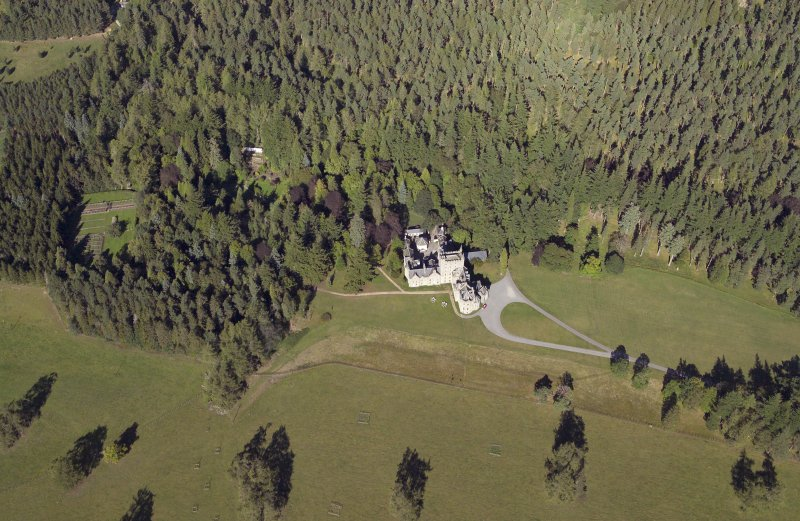 General oblique aerial view centred on the country house with the walled garden adjacent, taken from the SW.