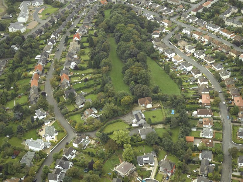 Oblique aerial view centred on the course of the Antonine Wall with the housing adjacent, taken from the ESE.