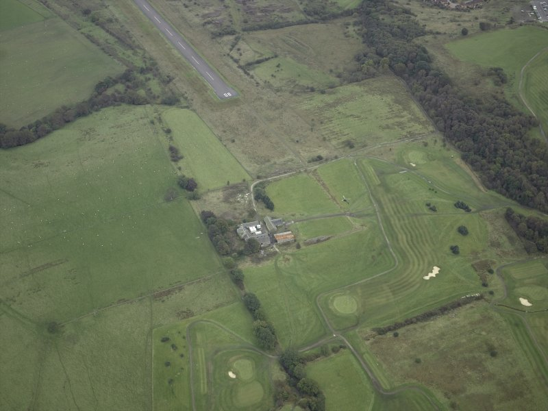 Oblique aerial view centred on the site of the Roman fort, possible Roman fortlet and the course of the Antonine Wall and the Military Way with the airfield adjacent, taken from the WNW.