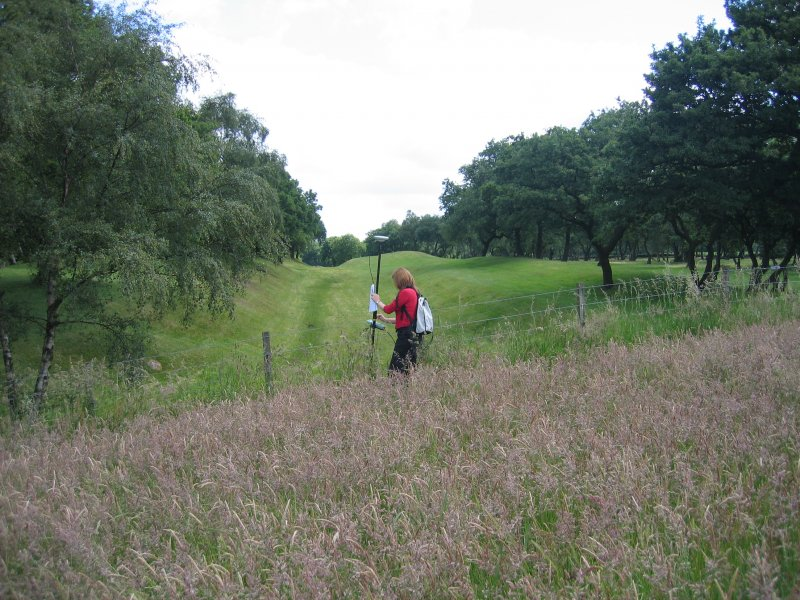 Ms G Brown from RCAHMS surveying at Seabegs Wood Roman Fortlet on the Antonine Wall.