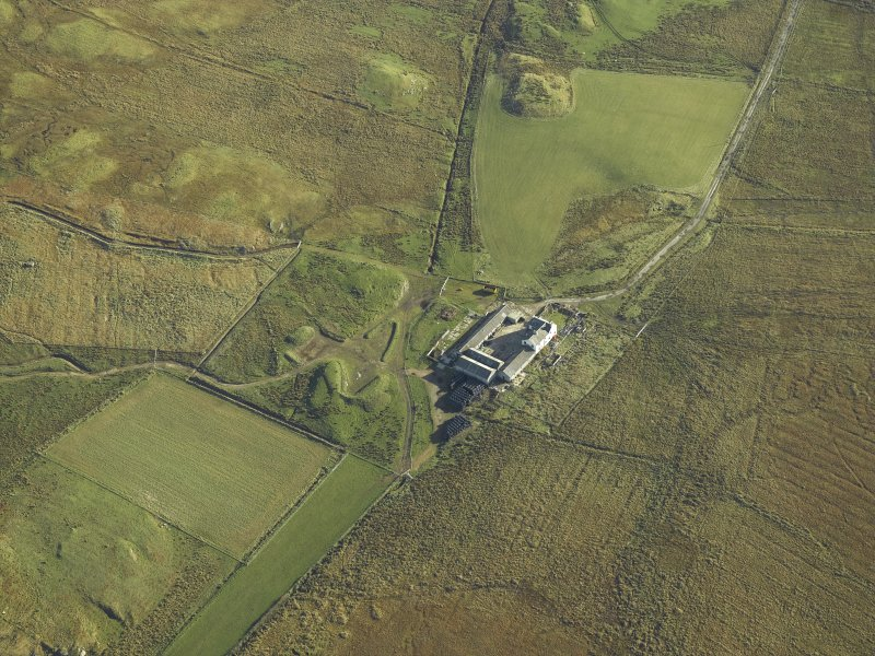 Oblique aerial view centred on the farmsteading and farmhouse, taken from the W.