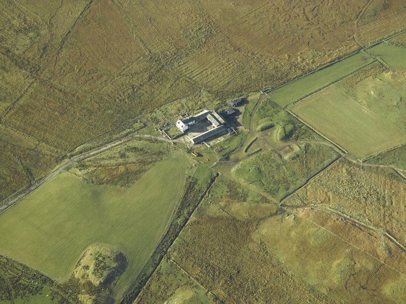 Oblique aerial view centred on the farmsteading and farmhouse, taken from the ENE.