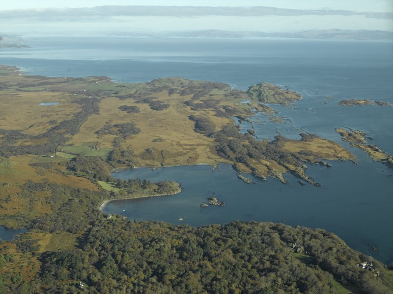 General oblique aerial view looking towards Loch a' Chnuic and Ardilistry Bay with the country house and houses in the foreground, taken from the SW.