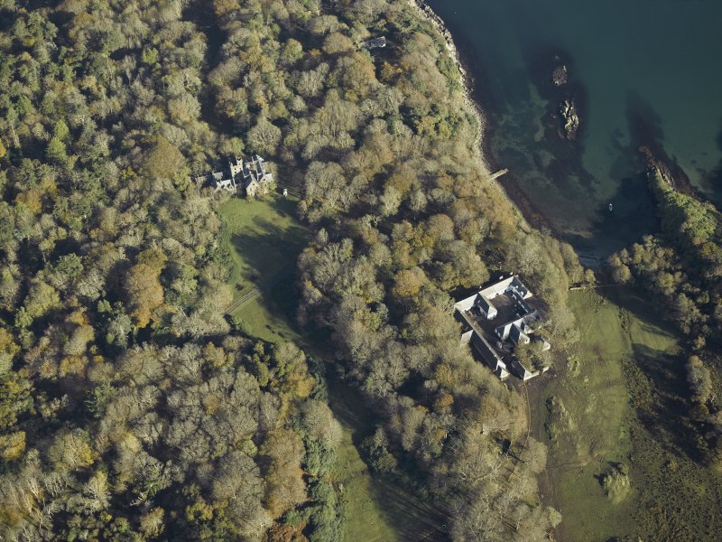 Oblique aerial view centred on the country house and house, taken from the SW.