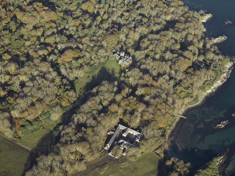 Oblique aerial view centred on the country house and house, taken from the SSE.