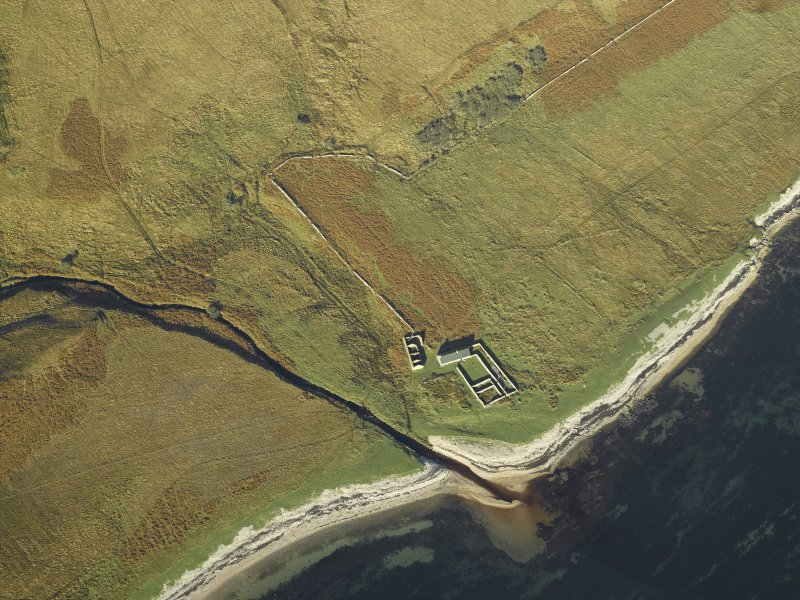 Oblique aerial view centred on the remains of the cottage, rig and sheepfold, taken from the SE.