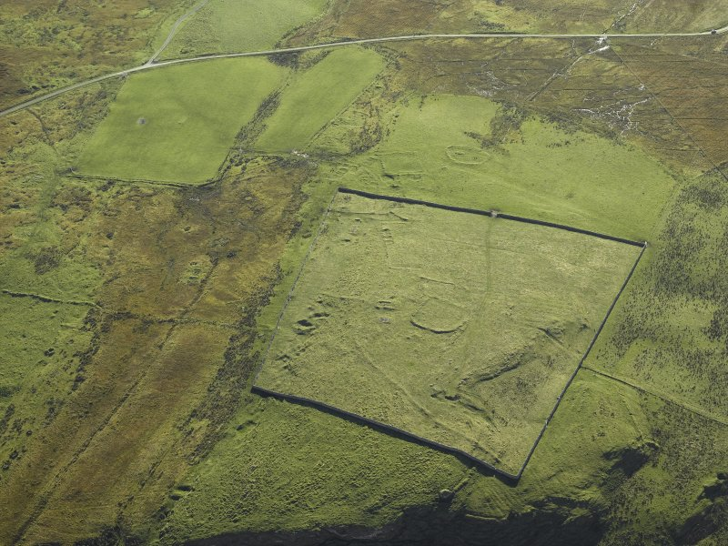 Oblique aerial view centred on the remains of the township, taken from the NNW.