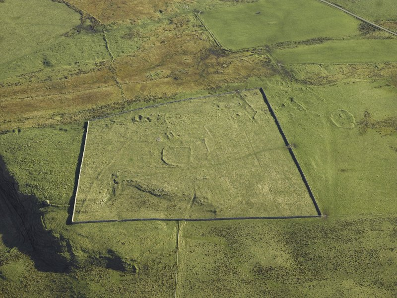 Oblique aerial view centred on the remains of the township, taken from the W.