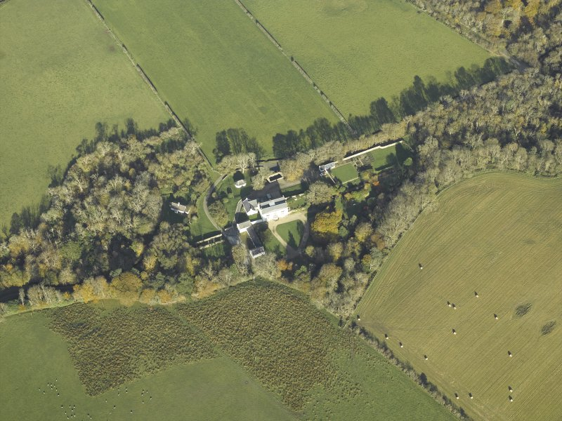 Oblique aerial view centred on the country house, taken from the S.