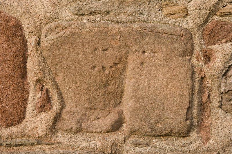Detail of carved fragment set into church wall