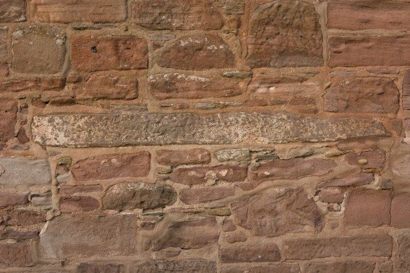 Detail of edge of carved slab set into church wall