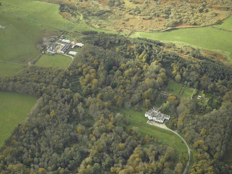 Oblique aerial view centred on the country house with the farmsteading and farmhouse adjacent, taken from the E.