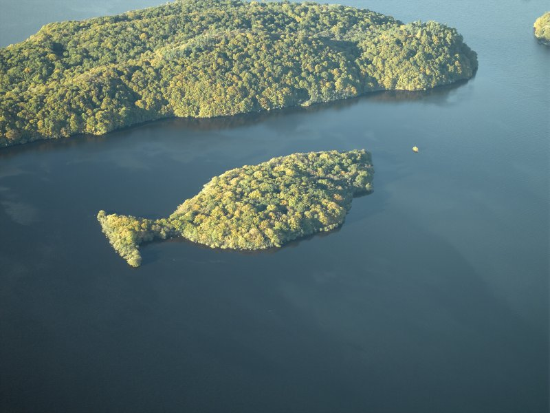 General oblique aerial view centred on the remains of the crannog and the islands, taken from the SE.