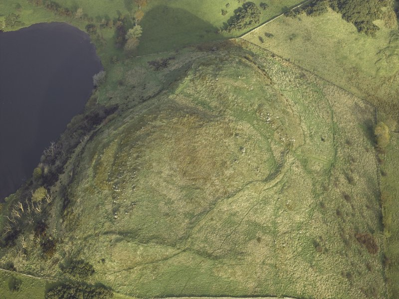 Oblique aerial view centred on the remains of the fort, taken from the SSW.