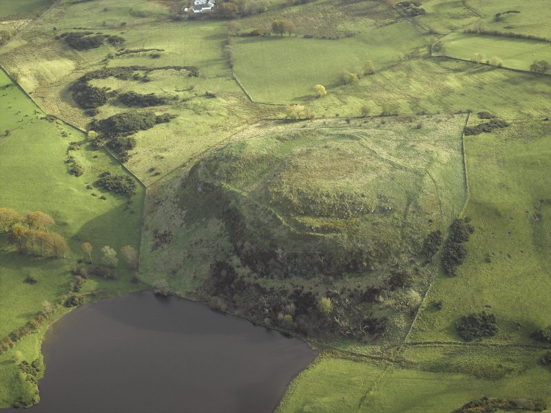 Oblique aerial view centred on the remains of the fort, taken from the WNW.