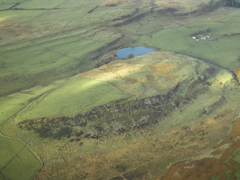 Oblique aerial view centred on the remains of the fort, taken from the ESE.