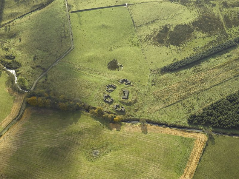 Oblique aerial view centred on the remains of the anti-aircraft battery, taken from the NNE.