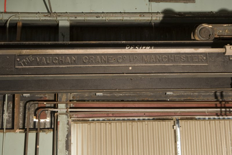 Interior.  Detail of makers plate on overhead gantry crane 'The Vaughan Crane Co. Ltd., Manchester'.