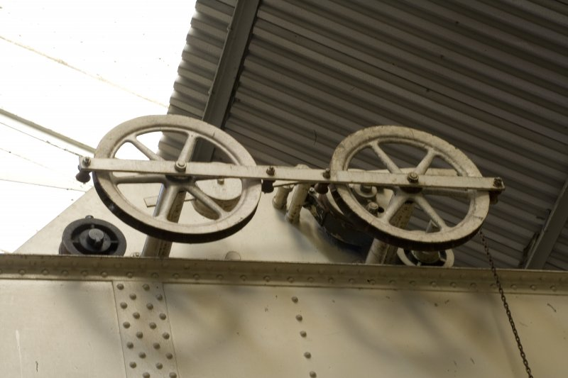 Interior.  detail showing pulley wheels on overhead crane gantry.