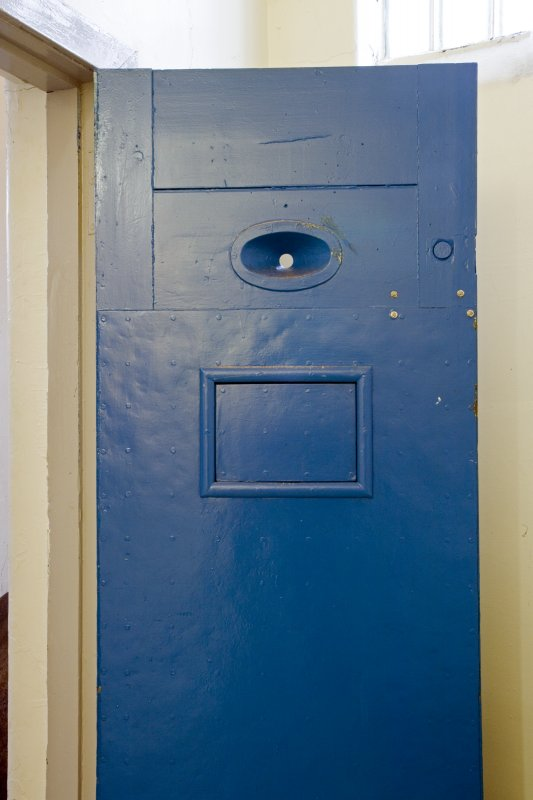Interior.  Detail of cell door with peep hole.