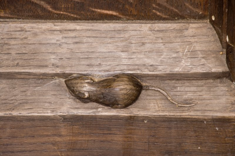 Detail of carved mouse on main door by Thomson of Kilburn. St Ninian's Episcopal Church, Troon.