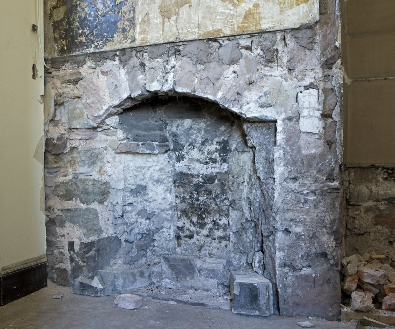 Interior. 1st floor, NE lobby, detail of remains of fireplace