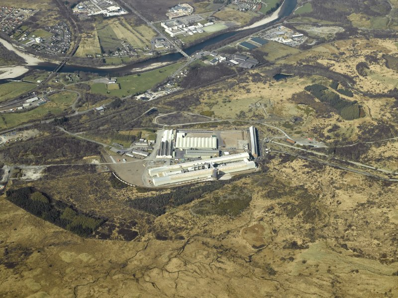 Oblique aerial view centred on the aluminium works and electricity generating station, taken from the S.