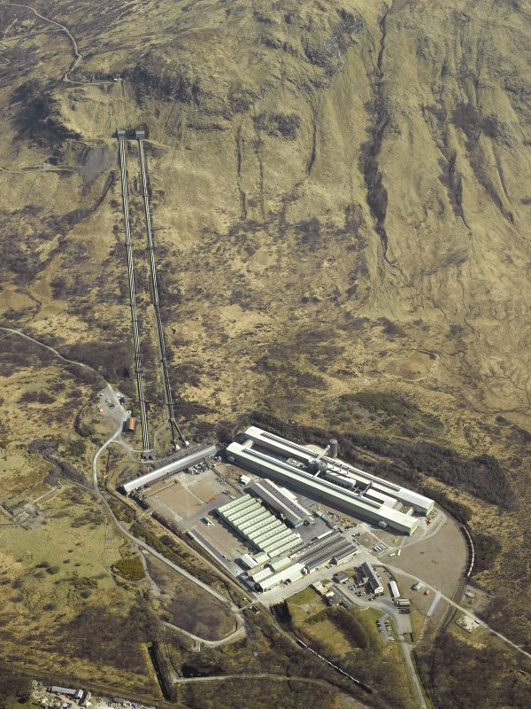 Oblique aerial view centred on the Lochaber aluminium works, Fort William, penstocks and electricity generating station, taken from the WNW.
