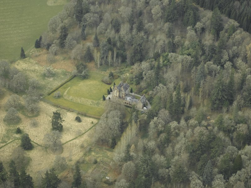 Oblique aerial view centred on the tower-house, taken from the NE.
