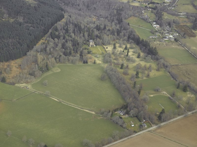 General oblique aerial view centred on the tower-house and gate-lodge, taken from the S.