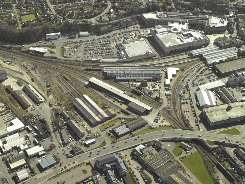 Oblique aerial view of the town centred on works with the railway station and garage adjacent, taken from the NNW.