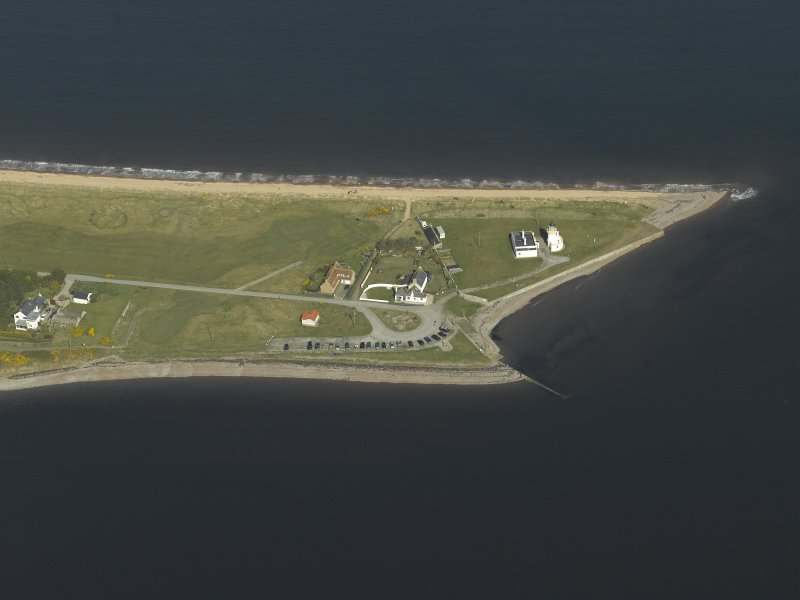 Oblique aerial view centred on the lighthouse, cottages and ferry house, taken from the SW.