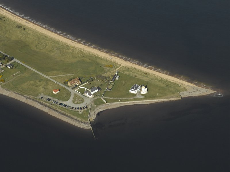 Oblique aerial view centred on Chanonry Point Lighthouse, cottages and ferry house, taken from the S.