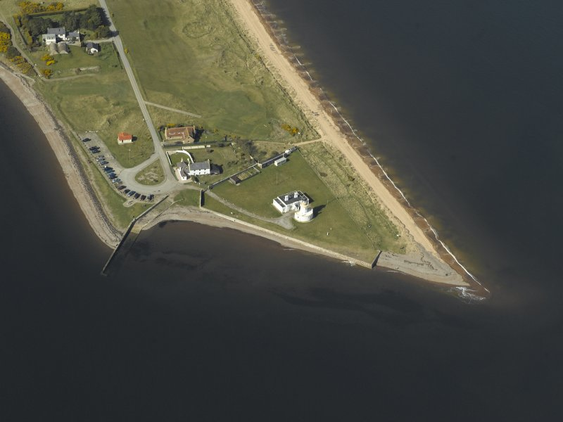 Oblique aerial view centred on the lighthouse, cottages and ferry house, taken from the SSE.