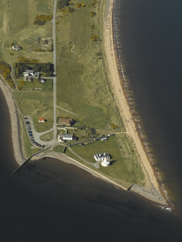 Oblique aerial view centred on the lighthouse, cottages and ferry house, taken from the SE.
