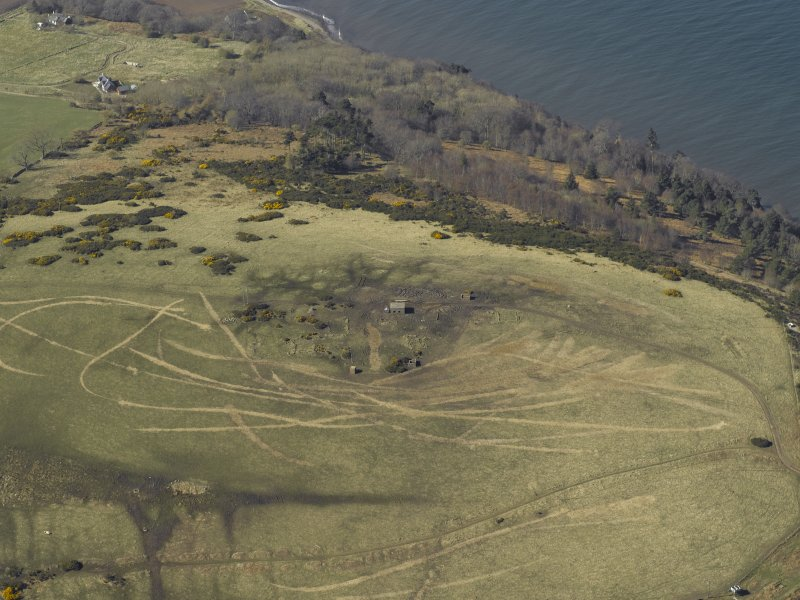 Oblique aerial view centred on the remains of the radar station and observation post, taken from the SE.