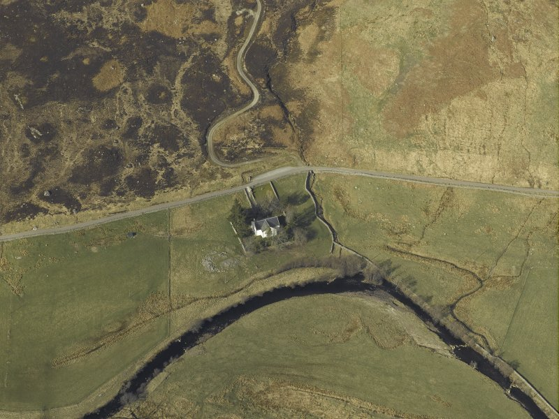 Oblique aerial view centred on the church and the remains of the broch, taken from the S.
