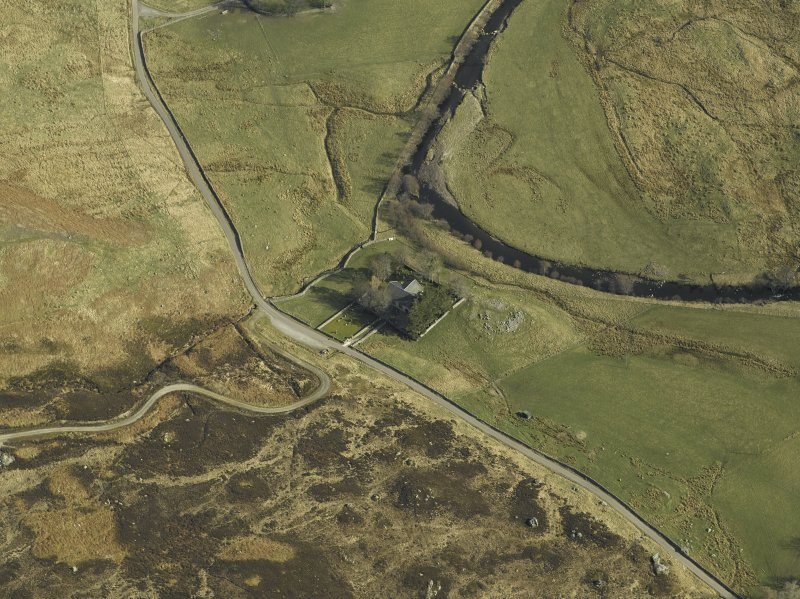 Oblique aerial view centred on the church and the remains of the broch, taken from the WNW.
