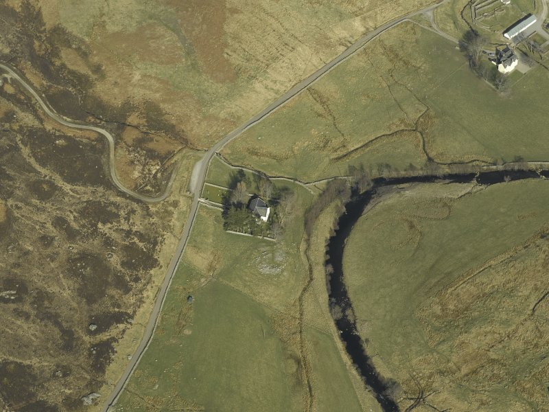 Oblique aerial view centred on the church and the remains of the broch, taken from the WSW.
